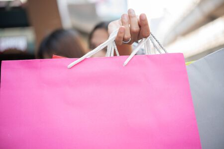 Woman holding colorful shopping bag