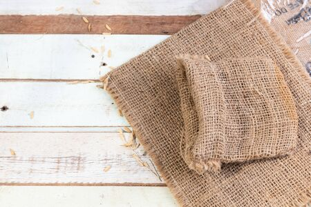Burlap or sackcloth on wood table.,top view