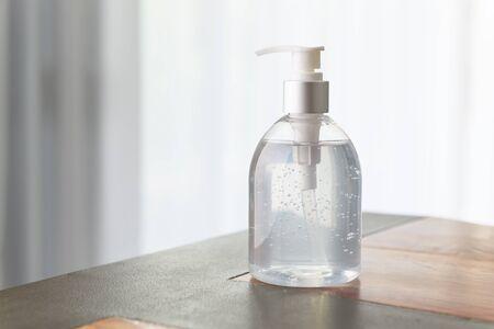 Hand sanitizer bottle or alcohol gel on white wood background for Coronavirus disease (COVID-19) prevention. Stock Photo