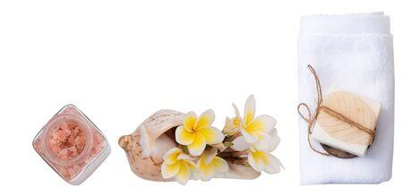 Spa wellness concept with milk soap,pink salt,white towel and plumeria flowers isolated Zdjęcie Seryjne