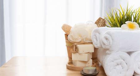 White towels,soap,luffa scrub,comb,candle and beautiful frangipani flower in clean white bathroom 版權商用圖片