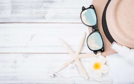 Summer background,straw hat ,towel,ear phone and sunglasses with star fish on white wood table,clipping path on sun glasses 版權商用圖片