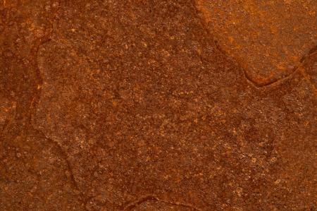 corrode: A rusty metal plate