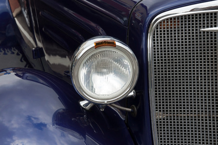 car grill: A headlight and grill from a classic car. Stock Photo