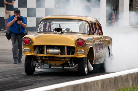 heats: Bowling Green, Kentucky - June 19, 2015: A driver heats his tires before a qualifying race at the Holley National Hot Rod Reunion in Bowling Green, Kentucky on June 19, 2015.