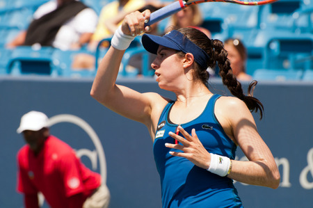 christina: Mason, Ohio - August 16, 2015: Christina McHale returns a shot in second round qualifiying at the Western and Southern Open in Mason, Ohio, on August 16, 2015. McHale defeated Polona Hercog 76 26 64.