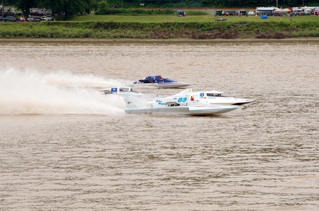 hydroplane: Madison, Indiana  - July 2, 2016:  Drivers racing in the  Grand National Hydroplane Final at the Madison Regatta in Madison, Indiana, July 2, 2016. Editorial