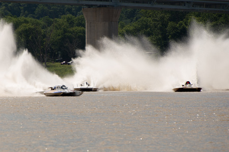 Madison, Indiana  - July 2, 2016:  Drivers compete in the Grand National Hydroplane Qualification Heat #1 at the Madison Regatta in Madison, Indiana, July 2, 2016.