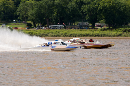 hydroplane: Madison, Indiana  - July 2, 2016:  Steve Kuhr II in the GNH 317, Danny Walls in the GNH 68, and matt Mattson in the GNH 76 race in the Grand National Hydroplane Qualification Heat #1 at the Madison Regatta in Madison, Indiana, July 2, 2016.