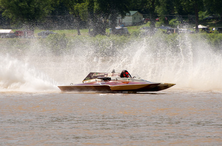 Madison, Indiana  - July 2, 2016:  Steve Kuhr II drives the GNH 317 in the Grand National Hydroplane Qualification Heat #1 at the Madison Regatta in Madison, Indiana, July 2, 2016. Editorial