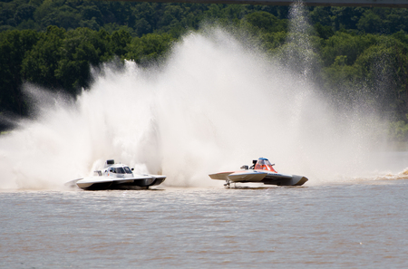 hydroplane: Madison, Indiana  - July 2, 2016:  Scott Liddycoat in the GNH 18 and Kevin Kreitzer in the GNH 515 race in  Grand National qualification heat at the Madison Regatta in Madison, Indiana, July 2, 2016. Editorial