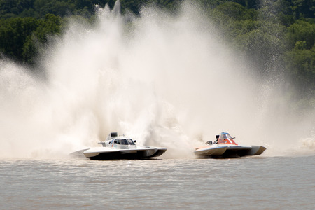 hydroplane: Madison, Indiana  - July 2, 2016:  Kevin Kreitzer in the GNH 515 and Scott Liddycoat in the GNH 18 race in the National Modified Saturday qualification heat #2 at the Madison Regatta in Madison, Indiana, July 2, 2016.