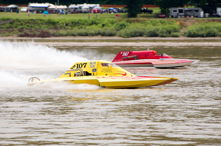 hydroplane: Madison, Indiana  - July 2, 2016:  Two hydorplanes racing in the National Modified Saturday qualification heat #3 at the Madison Regatta in Madison, Indiana, July 2, 2016. Editorial