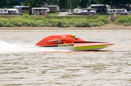 hydroplane: Madison, Indiana  - July 2, 2016:  Jamie Sartan drives the NM 21 in the National Modified Saturday qualification heat #3 at the Madison Regatta in Madison, Indiana, July 2, 2016. Editorial