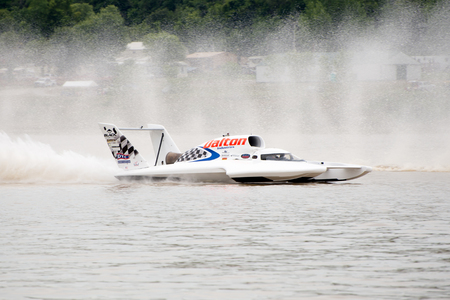 hydroplane: Madison, Indiana  - July 2, 2016:  Cal Phipps drives the Wiggins Racing U-27 in the Morgan Foods Unlimited Heat 1B at the Madison Regatta in Madison, Indiana, July 2, 2016.