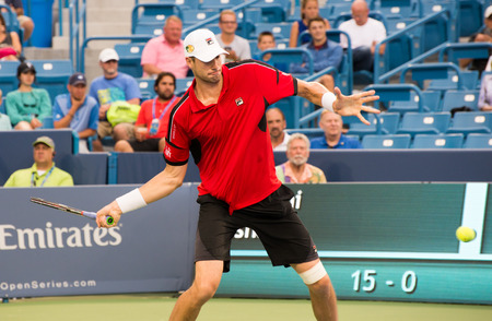 atp: Mason, Ohio - August 16, 2016: John Isner in a match at the Western and Southern Open in Mason, Ohio, on August 16, 2016. Editorial