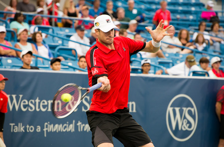 forehand: Mason, Ohio - August 16, 2016: John Isner in a match at the Western and Southern Open in Mason, Ohio, on August 16, 2016. Editorial
