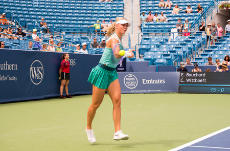 forehand: Mason, Ohio - August 13, 2016: Carina Wittoeft  in a qualifying match versus Eugenie Bouchard at the Western and Southern Open in Mason, Ohio, on August 13, 2016.
