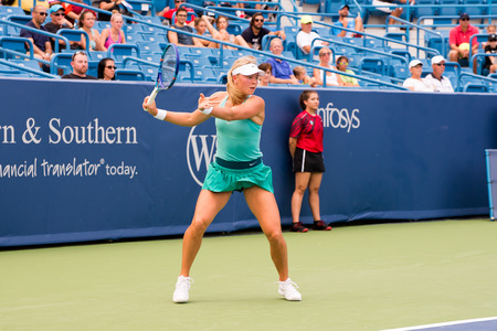 forehand: Mason, Ohio - August 13, 2016: Carina Witthoeft  in a qualifying match versus Eugenie Bouchard at the Western and Southern Open in Mason, Ohio, on August 13, 2016. Editorial