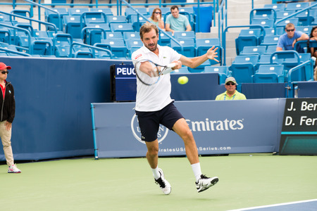 forehand: Mason, Ohio - August 15, 2016: Julien Benneteau in a first round match at the Western and Southern Open in Mason, Ohio, on August 15, 2016.  Bennetaue upset David Ferrer.
