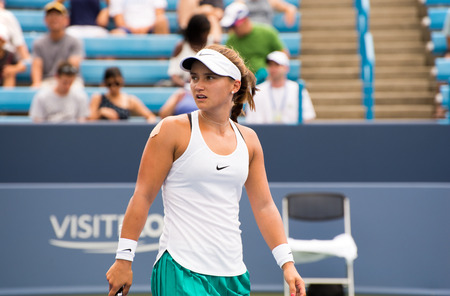 forehand: Mason, Ohio - August 13, 2016: Lauren Davis in a qualifying match versus Viktorija Golubic at the Western and Southern Open in Mason, Ohio, on August 13, 2016.