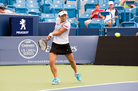 forehand: Mason, Ohio - August 14, 2016: Misaki Doi in a qualifying match at the Western and Southern Open in Mason, Ohio, on August 14, 2016.