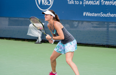 Mason, Ohio – August 17, 2017:  Martina Hingis and Yung-Jan Chan play in a doubles match at the Western and Southern Open tennis tournament in Mason, Ohio, on August 17, 2017. Stok Fotoğraf - 84384226
