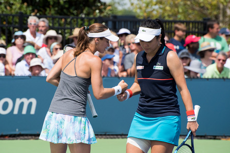 Mason, Ohio – August 17, 2017:  Martina Hingis and Yung-Jan Chan play in a doubles match at the Western and Southern Open tennis tournament in Mason, Ohio, on August 17, 2017. Editöryel