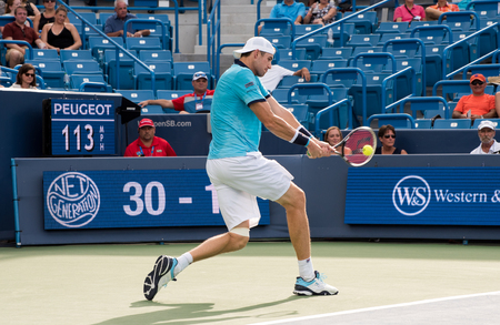 Mason, Ohio – August 17, 2017:  John Isner in a round of 16 match at the Western and Southern Open tennis tournament in Mason, Ohio, on August 17, 2017.