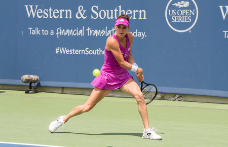 Mason, Ohio – August 15, 2017:  Agnieszka Radwanska in a first round match at the Western and Southern Open tennis tournament in Mason, Ohio, on August 15, 2017. Editorial