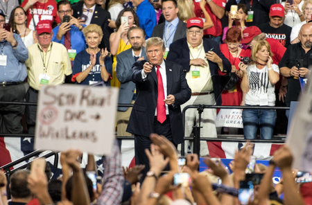 Tampa, Florida – July 31, 2018:  President Donald Trump addresses his supporters at a rally in Tampa, Florida, on July 31, 2018. Stock Photo - 105642848