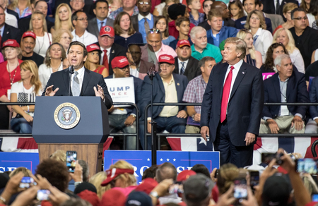 Tampa, Florida – July 31, 2018:  Representative Ron DeSantis addresses a crowd while President Donald Trump watches at a rally in Tampa, Florida, on July 31, 2018. Stock Photo - 105642850