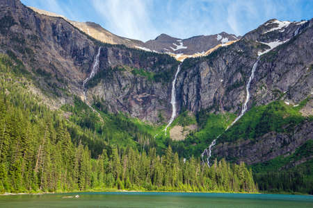 Waterfalls on mountains in Avalanche Basin in Glacier National Park. Stock Photo