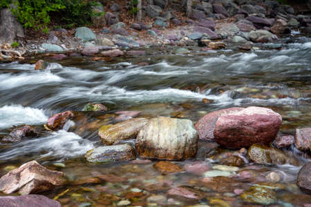 Colorful rocks in a creek in Montana