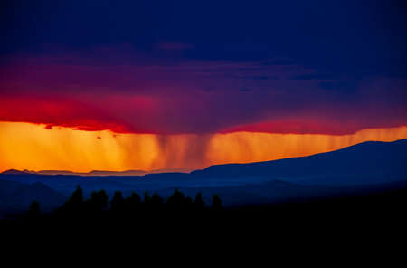 A colorful, fiery sunset in the desert