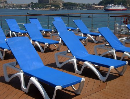 Blue Loungers in the deck of a cruiser near the pool                                                                photo