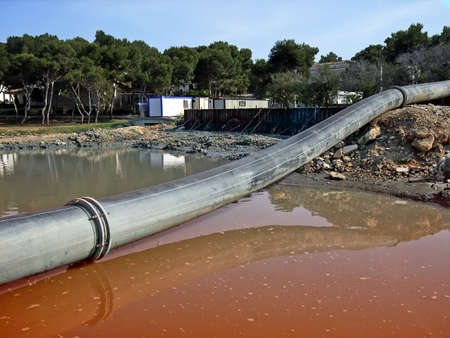 cesspool: Pipe dumping wastewater on the sea                                                                Stock Photo