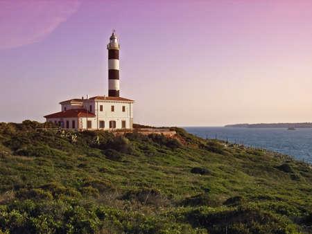 colom: Porto Colom Lighthouse in the southeast of Majorca (Balearic Islands - Spain) at dusk