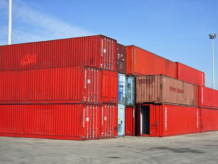 tonnage: Shipping containers stacked in a pier                                                                Stock Photo