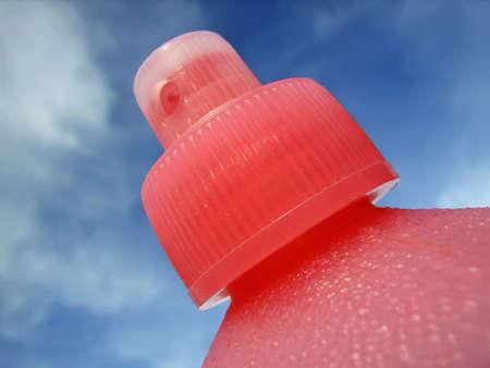 parfum: Pink Atomiser cap in a parfum bottle                                                                Stock Photo