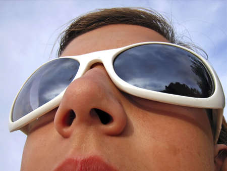 olfactory: Woman with Sunglasses looking at the sky