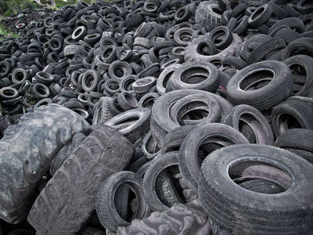 Lots of old tires dumped in a landfill in Spain