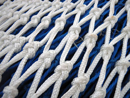 meshed: Detail of the knots on a fishing net                                                                Stock Photo