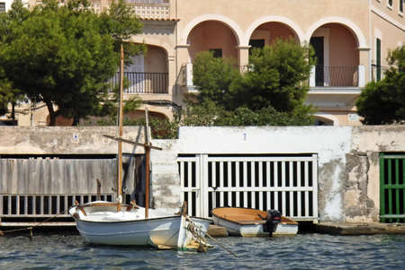 colom: typical boat shelters in Porto Colom (Mallorca - Spain)                                                                Stock Photo