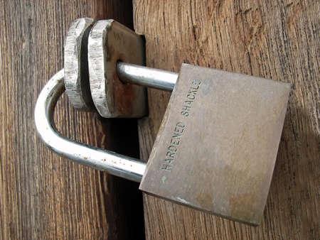 Padlock closing a wooden door                                                                photo