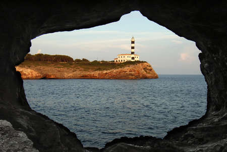 colom: Lighthouse in Porto Colom, seen from a cave Stock Photo