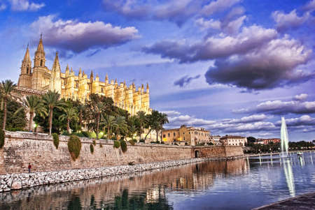 Gothic Cathedral of Palma de Majorca (Balearic Islands - Spain) at sunset photo