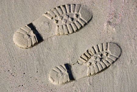 shoeprint: boot footprints on the sand of a beach Stock Photo