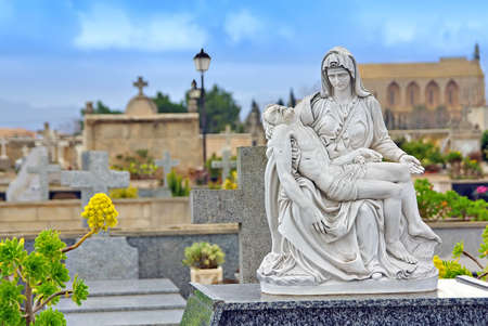 Statue in the cemetery of Alcudia (Majorca - Balearic Islands) photo