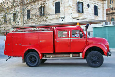 Old red firemen truck in an exhibition photo